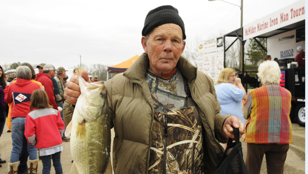 Big Bass: Earl Richie poses with his bass fish at the 2013 Sav-A-Life Bass Tournament. Richie was one of many fishing enthusiasts who came out to support Sav-A-Life, a non-profit organization that encourages those in pregnancy crisis situations to choose life over abortion. --Sarah Cook