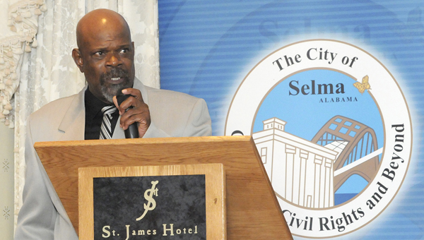 Sam Walker, organizer of the annual Bridge Crossing Jubilee, welcomes guests and visitors to the 2013 Bridge Crossing Jubilee Welcome Reception hosted by Selma Mayor George Evans and members of the Selma City Council Thursday evening at the St. James Hotel. -- Katie Wood