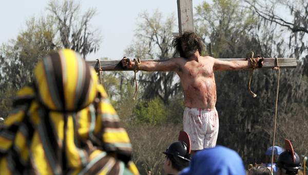 In remembrance of the death of Jesus Christ, residents and reenactors gathered at Bloch Park Friday to witness a reenactment of the crucifiction. --Katie Wood