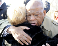 U.S. Rep. John Lewis (D-Ga.) hugs one of participants of Sunday's bridge crossing re-enactment across the Edmund Pettus Bridge, which Lewis led along with Vice President Joe Biden.  The group also included dozens of members of Congress and other government leaders. -- Katie Wood