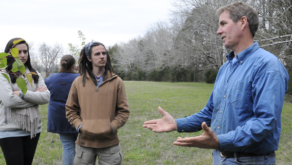 Chip Spencer, a sustainable farmer in Marion Junction, talks with students from Auburn University who toured the family's farm Saturday. -- Sarah Cook