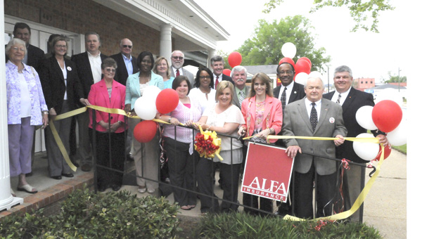 Staff members and those affiliated with ALFA Insurance in Selma cut the ribbon on their new location at 403 Broad Street, less than one block away from their previous location. --Ashley Johnson