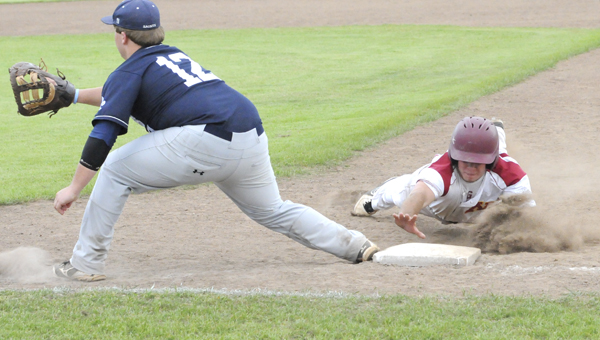 Morgan Academy senior Trevor Bates slides safely back to first base during Tuesday's game against Patrician Academy. Bates had two runs in Morgan's 5-4 senior day win over Patrician. -- Robert Hudson