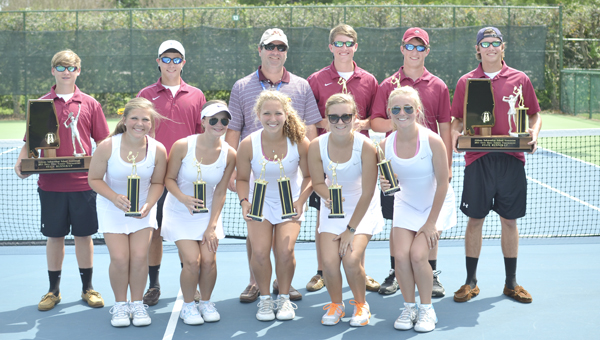 The Morgan Academy boys and girls tennis teams pose with the trophies they won at the AISA state tennis tournament in Montgomery this past week. Both teams finished as the state runner-up. -- Andrew Swindle