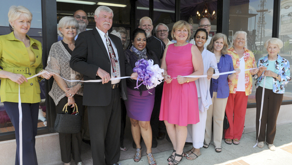 Business, economic and governmental leaders joined those at Selma's new boutique, Taja's, during their grand opening and ribbon cutting Monday. -- Tim Reeves