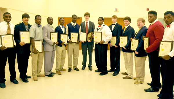 When Morgan Academy senior, Porter Rivers, accepted the 2013 Paul M. Grist Boy of the Year award, he told all 12 other nominees they were truly winners too. Rivers, center, is pictured with the nominees who represent all of the area high schools. -- Ashley Johnson