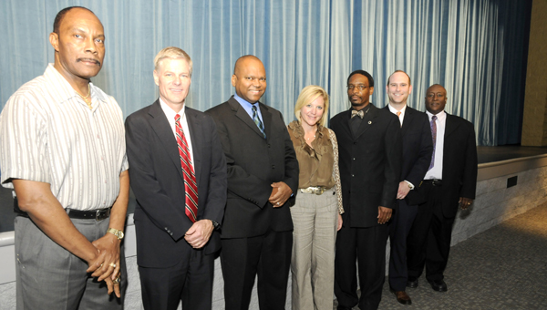 From left, vice principal of Selma High School Woodie Jackson, District Judge Bob Armstrong, District Attorney Michael Jackson, Jana Garner, Judge Marvin Wiggins, Woody Jones and Judge Collins Pettaway Jr. presented information on Law Day to Selma High School on Wednesday. -- Ashley Johnson