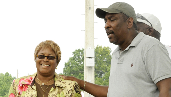 In honor of: Selma City Councilman Michael Johnson, who represents Ward 8 on the Selma City Council, gives remarks Wednesday at the dedication of the press box at the Ernest L. Bennett Baseball Field in honor of former councilwoman Jannie Venter, left. --Sarah Cook