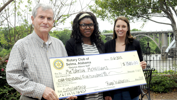 Me'Shellai McWilliams received a $15,000 scholarship from the Rotary Club Monday. Above, Mike Jung, scholarship committee chairman, and Renee Wilkerson, Rotary president, award the check. --Sarah Cook