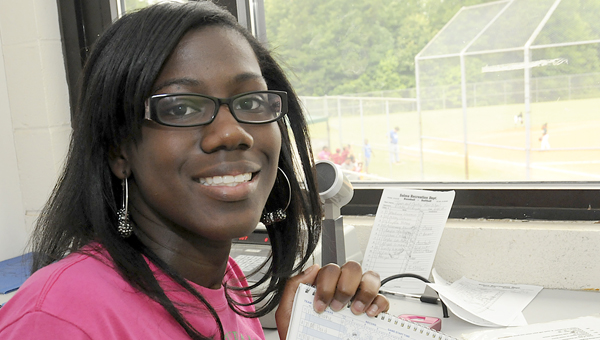 Selma High's Emilea Moultrie is one of the voices fans hear during youth baseball and softball games at the Dallas County Sportsplex.  Moultrie is in her first season working at the Sportsplex and has already fallen in love with the work. -- Roderick Mitchell