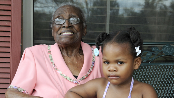 Cornelia Reese sits with her great-granddaughter Jerryanna Heard, called 'Peaches,' Monday morning. Reese will celebrate her birthday Tuesday, turning 104. Reese claims Peaches is the reason she has stayed so young, helping to take care of her since she was born. --Ashley Johnson