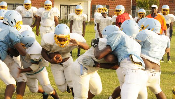 Selma running back flies through a hole during a practice drill Thursday at Selma High School.--Daniel Evans