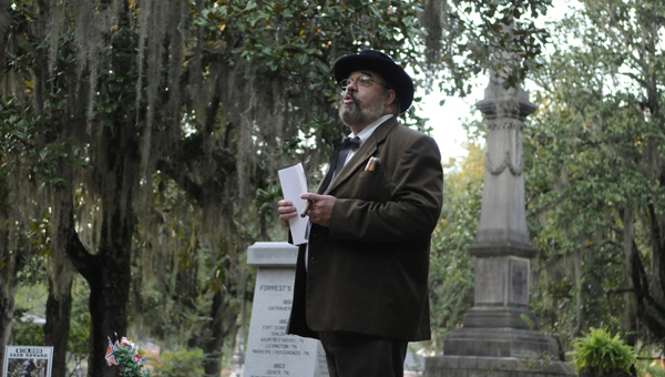 An actor playing George Washington Gayle talks about the meaning behind Confederate Circle on Saturday during the Haunted History Tours at Old Live Oak Cemetery.