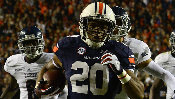 Auburn running back Corey Grant runs for the Tigers' second touchdown of the first half against Florida Atlantic. Auburn pulled away in the second half to win 45-10.--Todd Van Emst