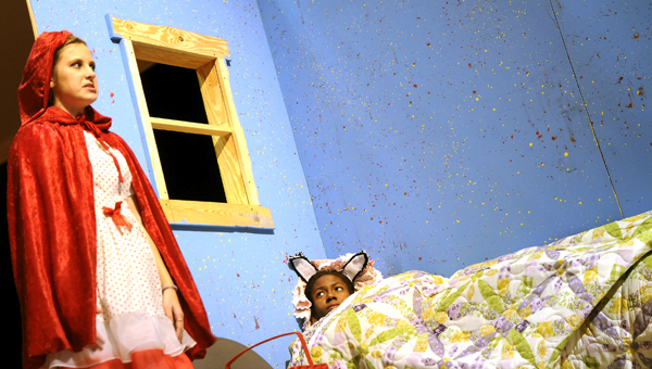 Little Red Riding Hood, left, played by Abreanna Kuhn, and the Big Bad Wolf, played by Karissa Smiley, act out a scene on Tuesday at Wallace Community College's Goodwin Theater. In the scene Smiley is pretending to be Kuhn's grandmother.