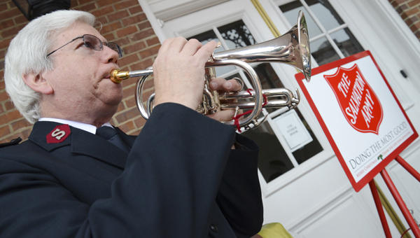 Major Steve Welch performs on his bugle in front of Selma City Hall during a ceremony marking the start of the Salvation Army's Red Kettle Campaign. -- Jay Sowers