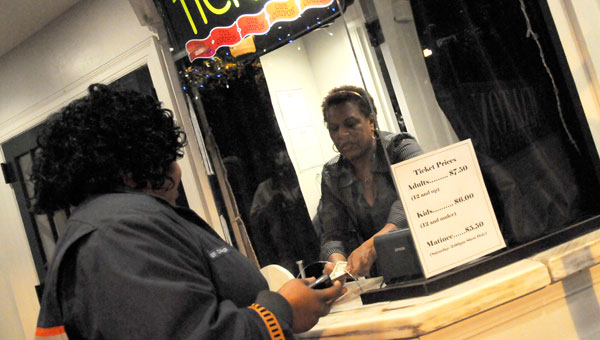 """Theater operator Sharon Jackson sells a tick to Regina Drane to see """"A Medea Christmas"""" on Friday. David and Sharon Jackson decided to end management after the city failed to approve a transition plan or present a counter offer. (Josh Bergeron 