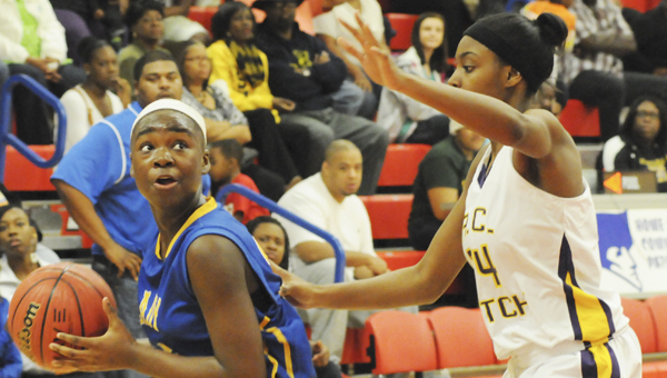 Shatavia Moore prepares to go up for a shot in Keith's win over R. C. Hatch Saturday night at Wallace Community College Selma. The Bears held on to win the girls championship in the Dallas County Classic Tournament.--Daniel Evans