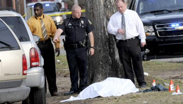 Investigators with the Selma Police Department and the Alabama Bureau of Investigation review the scene Wednesday afternoon where a suspect, reportedly weilding a hatchet, was shot and killed by Selma Police. -- Josh Bergeron