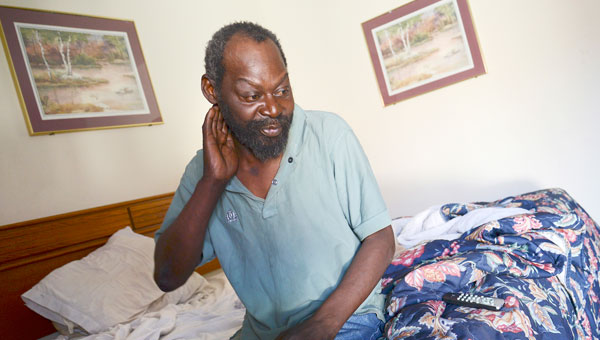 James Harrison looks around his hotel room at the Budget Inn last week. Harrison, who is homeless, was among the many people who had a room at the hotel reserved and paid for by the Edmundite Missions. (Jay Sowers | Times-Journal)