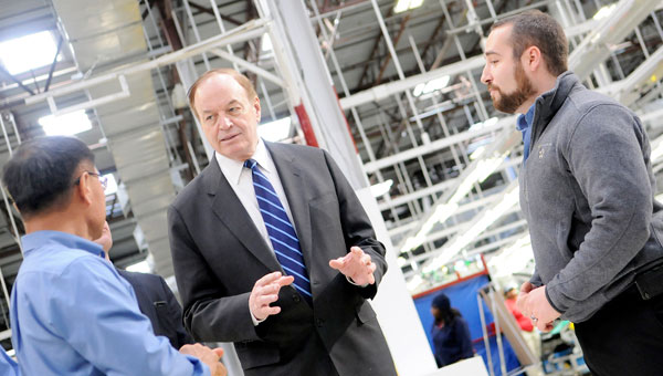 U.S. Sen. Richard Shelby, R-Ala., talks to Hanil E Hwa officials during his tour of the Hyundai supplier Tuesday. Shelby's trip to Dallas County is part of a larger tour around the state to visit local businesses. (Josh Bergeron | Times-Journal)