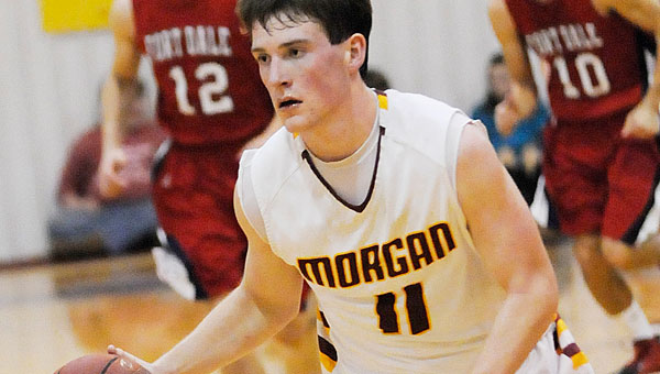 Connor Henderson dribbles the ball down the floor in the Senators' loss to Fort Dale. (Daniel Evans   Times-Journal)