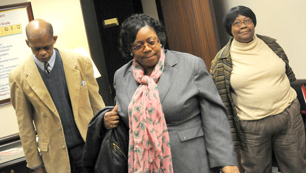 Selma Superintendent of Education Gerald Shirley, left, school board member Brenda Randolph Obomanu and school board attorney Katy Campbell leave a meeting held in Montgomery Wednesday with State Superintendent of Education Dr. Tommy Bice. (Josh Bergeron | Times-Journal)