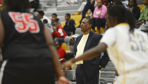 Selma girls head coach Anthony Harris looks on as his team takes on Sumter Central. The Saints have won 20 or more games for eleven consecutive seasons, but the Lady Saints have never won a state championship. --Jay Sowers