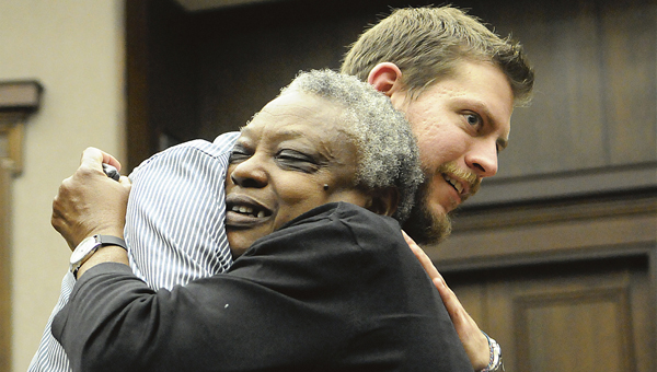 Doug Bacon, who on Jan. 8, 2013, saved Priscilla Woods after she jumped from the Edmund Pettus Bridge, receives a hug from Priscilla's mother, Beatrice Woods, during a meeting at Selma City Hall to honor Bacon's heroism. -- File Photo