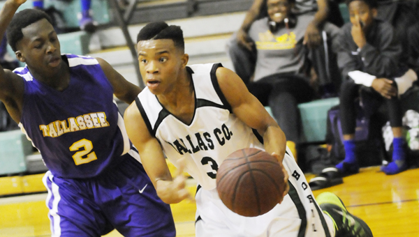 Dallas County Hornets point guard Raheem Phillips drives past a Tallassee defender in Friday afternoon's game. The contest was played as an in-school game and started at 1 p.m.--Daniel Evans