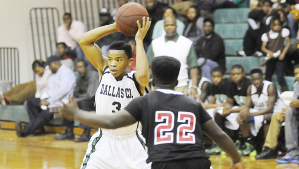 Dallas County point guard Raheem Phillips looks to pass in Saturday night's win over Southside High School. Phillips scored 14 points for the Hornets in the game.--Daniel Evans