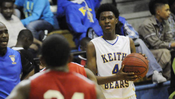 Keith's Anfernee Simmons looks to pass in Friday night's game against Southside. SImmons scored 23 points in the game as the Bears survived a late Panthers rally for a big win.--Daniel Evans