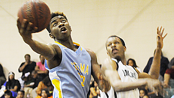 Selma's Michael Griffin goes up for a layup in Thursday night's game against Dallas County.--Daniel Evans