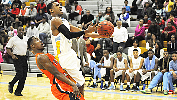 Selma's Keyshawn Ford goes up for a layup while a Francis Marion defender tries not to foul him. Ford led the Saints with 14 points in the game, but the Rams won the game 49-48.  Selma's next game will be Tuesday, Jan. 7 against Demopolis. --Daniel Evans