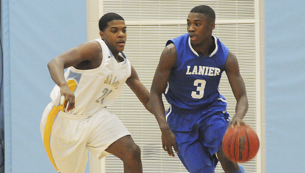 Selma's Aderick Moore attempts to guard a player for Sidney Lanier in Tuesday night's game at Selma High School.