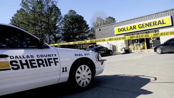 Investigators with the Dallas County Sheriff's Department respond to a reported robbery and shooting at the Dollar General location in Orrville -- Josh Bergeron