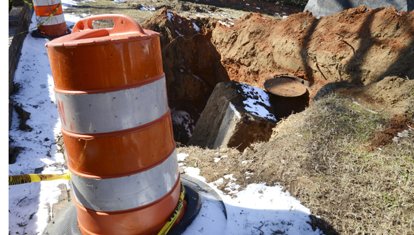Work to uncover the cause of sinkhole under Selma's Bienville Park hit a snag this week as workers' progress has been blocked by a large piece of concrete that had previously served as the base for the park's stone monument. (Jay Sowers   Times-Journal)