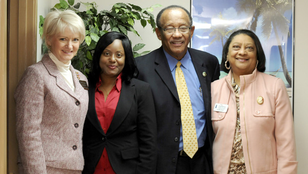 Massage therapist Joyce Hampton, middle left, pictured Selma-Dallas Chamber of Commerce executive director Sheryl Smedley, far left, Selma Mayor George Evans, middle right, and Selma resident Armelia Oliver, far right, inside of Essence of Therapeutic Touch Wednesday at the business' open house. (Sarah Robinson   Times Journal)