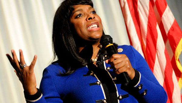 U.S. Rep. Terri Sewell talks to the crowd during Tuesday's town hall meeting in Selma. (Josh Bergeron | Times-Journal)