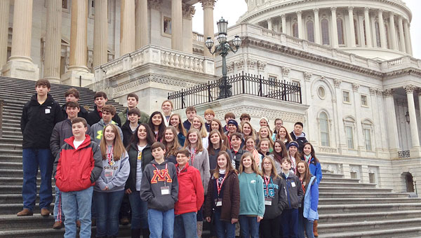 Students from Morgan Academy pose for a photograph in front of the U.S. Capitol Building in Washington, D.C. earlier this month.