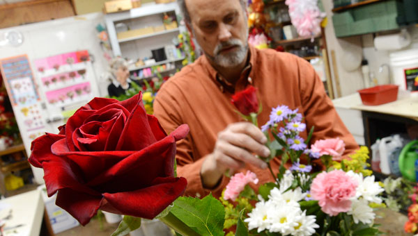 Bill Albritton, owner of Albritton's Flowers, works on a floral arrangement Thursday afternoon in advance of Valentine's Day. (Jay Sowers | Times-Journal)