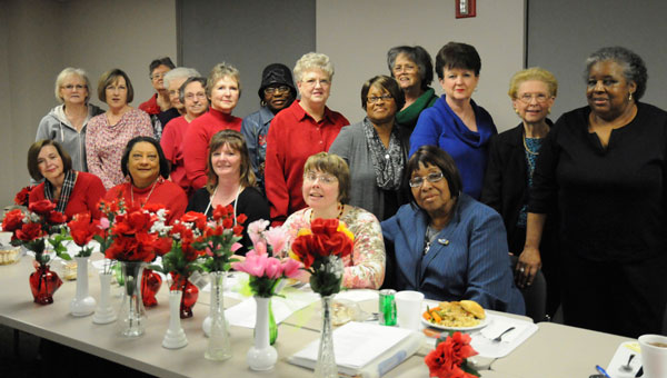 Members of the Alpha One Civitan pose with some of the vases they prepared this week to be delivered to residents at Warren Manor. (Sarah Robinson | Times-Journal)