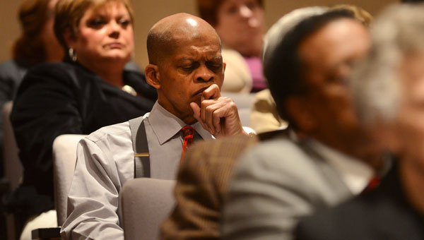 Selma Superintendent of Education Gerald Shirley, center, furrows his brow upon hearing the State Department of Education will be taking over the Selma City School System.  The unanimous vote came during Wednesday's state board meeting in Montgomery. (Jay Sowers | Times-Journal)