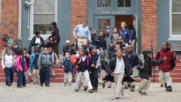 Students and teachers file through the front doors of Byrd Elementary School in Selma Monday afternoon.  The Alabama State Board of Education is poised to vote on a measure that could lead to the state taking control of the Selma City School System. (Jay Sowers | Times-Journal)