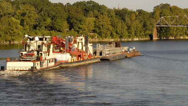 File Photo | Times-Journal Not reviewed: A barge heads up the Alabama River in Selma.  The Dallas County portion of the Alabama River was not included in a recent survey by the Army Corps of Engineers.