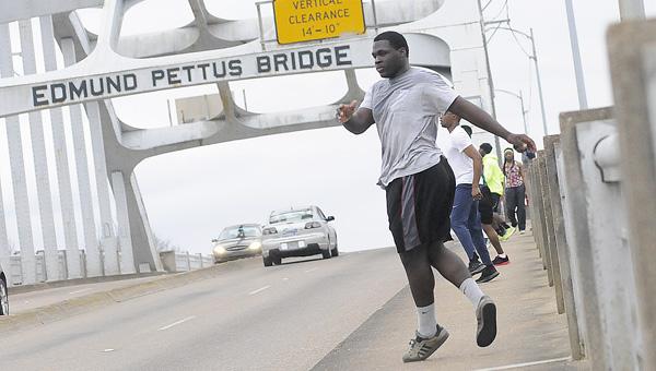 Concordia College Alabama's Dijon Vaughans and teammates do an agility drill Tuesday on the Edmund Pettus Bridge.--Daniel Evans
