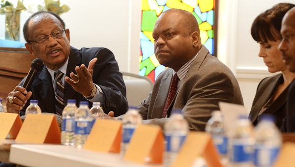 Selma Mayor George Evans, left, addresses a panel of community leaders during a public meeting Saturday at Mt. Ararat Missionary Baptist Church. -- Jay Sowers
