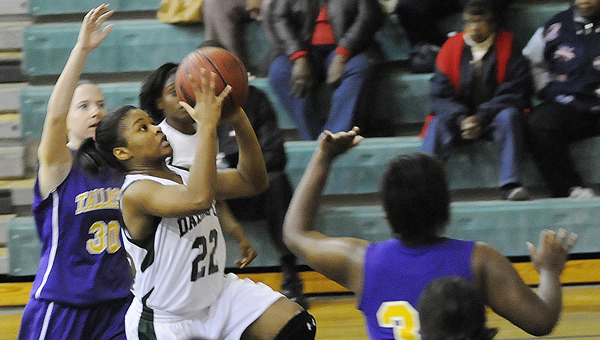 Dallas County's Casmisha Moore goes up for a shot during the Hornets game versus Tallassee last week.  The Lady Hornets will play their first postseason game Monday against Holtville at Childersburg High School.  The Lady Hornets are the No. 4 seed in Class 4A,  Area 6. --Daniel Evans