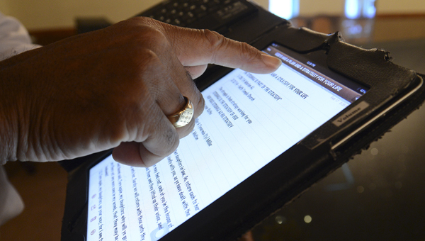 Pastor John Grayson, of Selma's Gospel Tabernacle Church, said he often uses his iPad to refer back to messages he has given over recent years. -- Jay Sowers