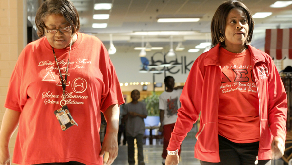 Members of the Selma Alumae chapter of Delta Sigma Theta Sorority Verlette Ferguson, left, and Carolyn Berry, right, take a lap around the inside of Selma Mall Saturday morning as a part of their sorority's Go Red Healthy Heart Walk. The walk included six laps around the Selma, which is the equivalent of one mile.